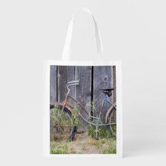 USA, Oregon, Bend. A dilapidated old bike Reusable Grocery Bag