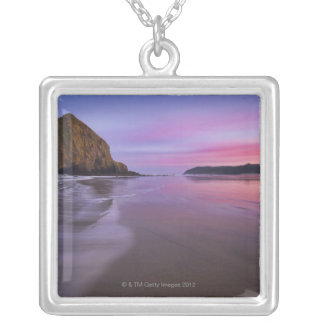 USA, Oregon, Clatsop County, Haystack Rock and Silver Plated Necklace