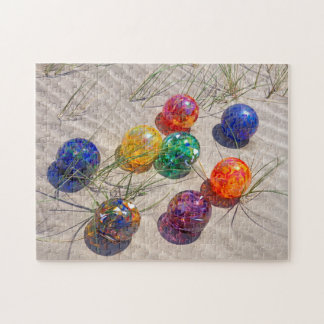 USA, Oregon. Colorful Glass Floats On Sand Dune Jigsaw Puzzle