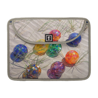 USA, Oregon. Colorful Glass Floats On Sand Dune Sleeves For MacBook Pro