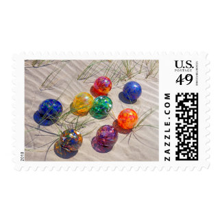 USA, Oregon. Colorful Glass Floats On Sand Dune Postage Stamp