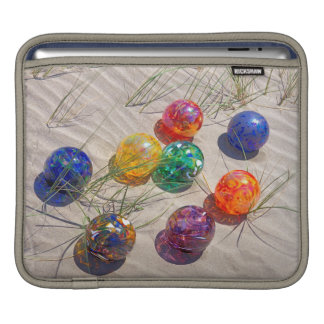 USA, Oregon. Colorful Glass Floats On Sand Dune Sleeve For iPads