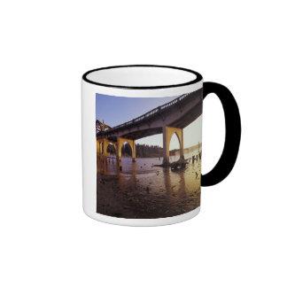 USA, Oregon, Florence. Siuslaw Bridge and Coffee Mugs