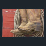 "USA, Oregon, Seneca, Ponderosa Ranch. Close-up Hand Towel<br><div class=""desc"">USA,  Oregon,  Seneca,  Ponderosa Ranch Close-up of cowboy boots and rope hanging on a weathered red wooden barn wall   Wendy Kaveney / Jaynes Gallery / DanitaDelimont.com</div>"