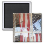 USA, Oregon, Shaniko. Flag in window next to 2 Inch Square Magnet