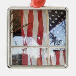 USA, Oregon, Shaniko. Flag in window next to Metal Ornament
