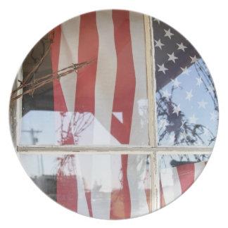 USA, Oregon, Shaniko. Flag in window next to Plate