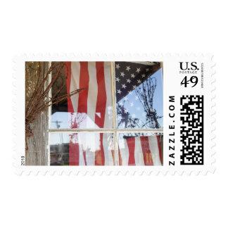 USA, Oregon, Shaniko. Flag in window next to Postage