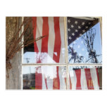 USA, Oregon, Shaniko. Flag in window next to Postcard