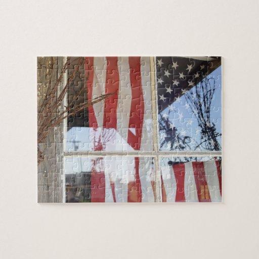 USA, Oregon, Shaniko. Flag in window next to Puzzle