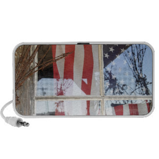 USA, Oregon, Shaniko. Flag in window next to Notebook Speakers