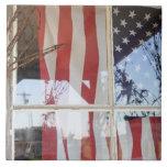 USA, Oregon, Shaniko. Flag in window next to Tile