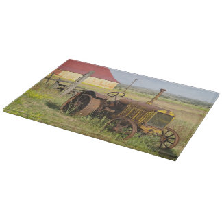 USA, Oregon, Shaniko. Rusty vintage tractor in Cutting Board