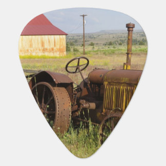 USA, Oregon, Shaniko. Rusty vintage tractor in Guitar Pick