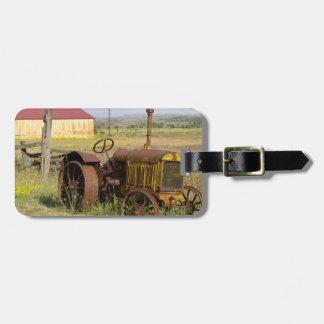 USA, Oregon, Shaniko. Rusty vintage tractor in Luggage Tag
