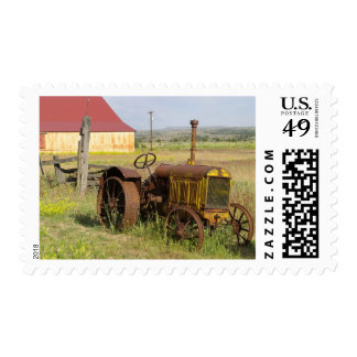 USA, Oregon, Shaniko. Rusty vintage tractor in Postage Stamps