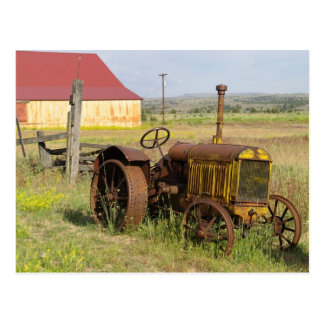 USA, Oregon, Shaniko. Rusty vintage tractor in Postcard