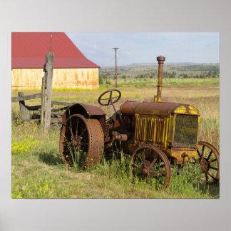 USA, Oregon, Shaniko. Rusty vintage tractor in Poster
