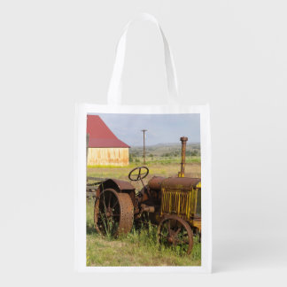 USA, Oregon, Shaniko. Rusty vintage tractor in Reusable Grocery Bag