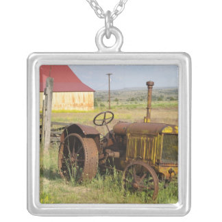USA, Oregon, Shaniko. Rusty vintage tractor in Silver Plated Necklace