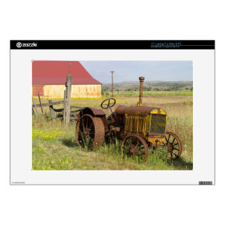"USA, Oregon, Shaniko. Rusty vintage tractor in 15"" Laptop Skin"