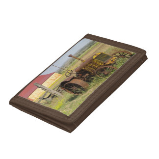 USA, Oregon, Shaniko. Rusty vintage tractor in Tri-fold Wallets