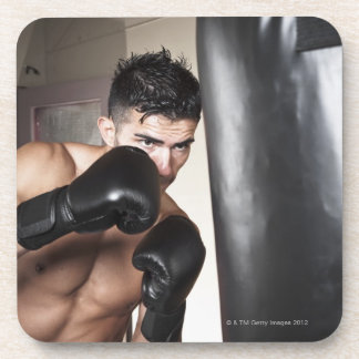 USA, Seattle, Portrait of young man boxing in Beverage Coaster