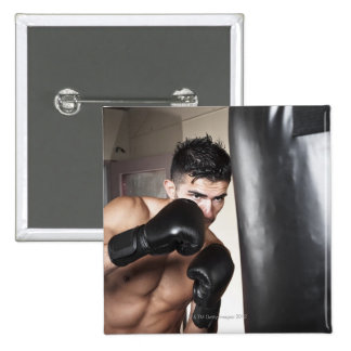 USA, Seattle, Portrait of young man boxing in Buttons