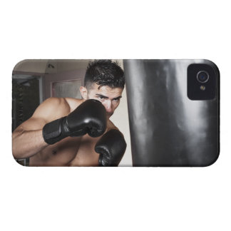 USA, Seattle, Portrait of young man boxing in iPhone 4 Covers