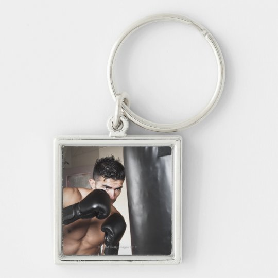 USA, Seattle, Portrait of young man boxing in Keychain