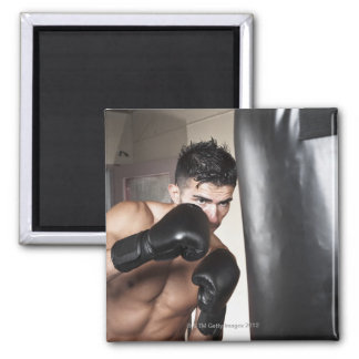 USA, Seattle, Portrait of young man boxing in Magnet