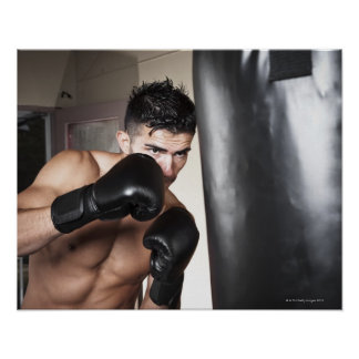 USA, Seattle, Portrait of young man boxing in Poster