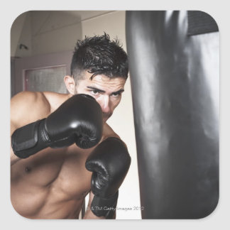 USA, Seattle, Portrait of young man boxing in Square Sticker
