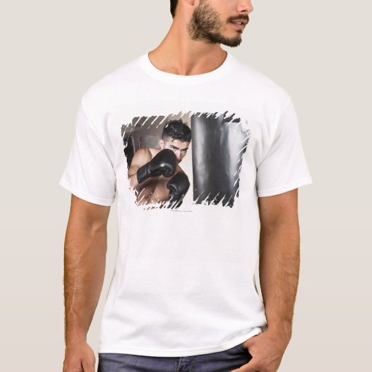 USA, Seattle, Portrait of young man boxing in T-Shirt