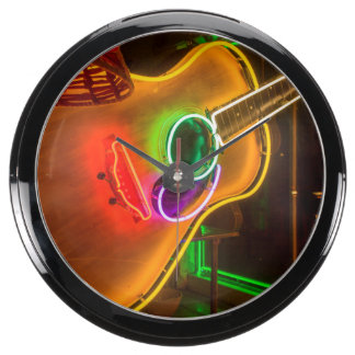 USA, Texas, Austin. Neon Guitar At Blackmail Fish Tank Clocks