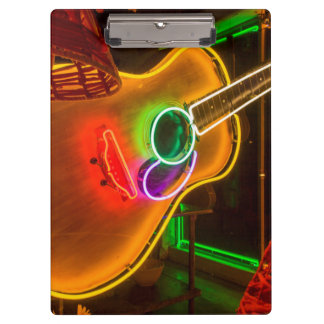 USA, Texas, Austin. Neon Guitar At Blackmail Clipboards