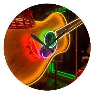 USA, Texas, Austin. Neon Guitar At Blackmail Large Clock