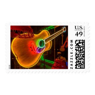 USA, Texas, Austin. Neon Guitar At Blackmail Postage Stamp
