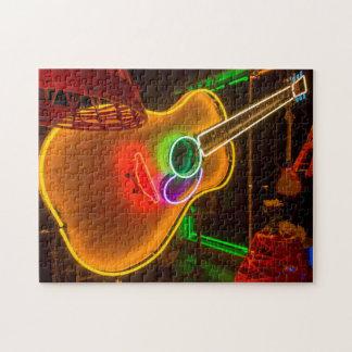 USA, Texas, Austin. Neon Guitar At Blackmail Puzzle