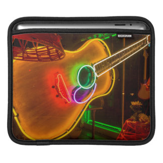 USA, Texas, Austin. Neon Guitar At Blackmail Sleeve For iPads
