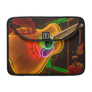USA, Texas, Austin. Neon Guitar At Blackmail Sleeve For MacBooks
