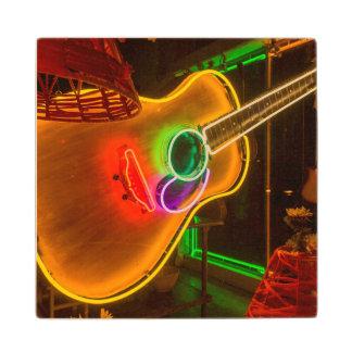 USA, Texas, Austin. Neon Guitar At Blackmail Wooden Coaster