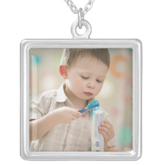 USA, Utah, Lehi, boy (2-3) brushing teeth Silver Plated Necklace
