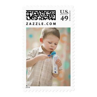 USA, Utah, Lehi, boy (2-3) brushing teeth Stamp