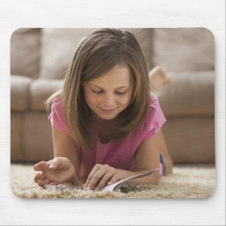 USA, Utah, Lehi, Girl (10-11) lying on rug, Mouse Pad
