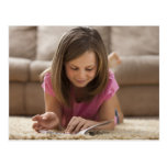 USA, Utah, Lehi, Girl (10-11) lying on rug, Postcard