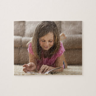 USA, Utah, Lehi, Girl (10-11) lying on rug, Puzzles