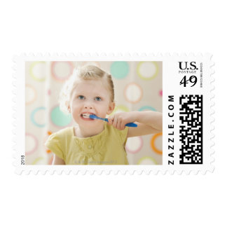 USA, Utah, Lehi, girl (2-3) brushing teeth Postage
