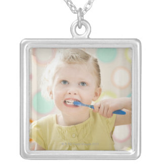 USA, Utah, Lehi, girl (2-3) brushing teeth Silver Plated Necklace