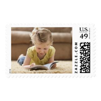 USA, Utah, Lehi, Girl (2-3) lying on rug, Postage Stamp